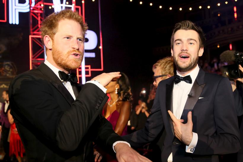 Britain's Prince Harry greets comedian Jack Whitehall