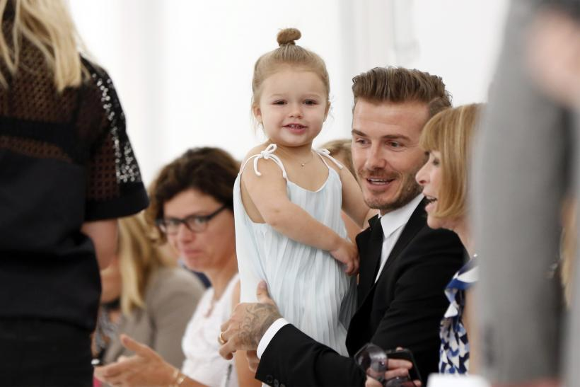 Former England soccer captain David Beckham holds his daughter Harper