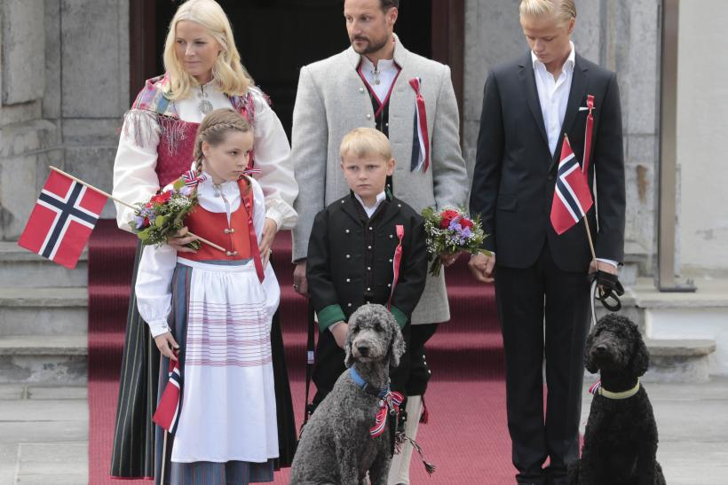 Norway's Crown Princess Mette-Marit, Prince Sverre Magnus, Crown Prince Haakon, Princess Ingrid Alexandra and Marius Borg Hoiby look at children taking part in a parade in celebration of the Norwegian Constitution Day