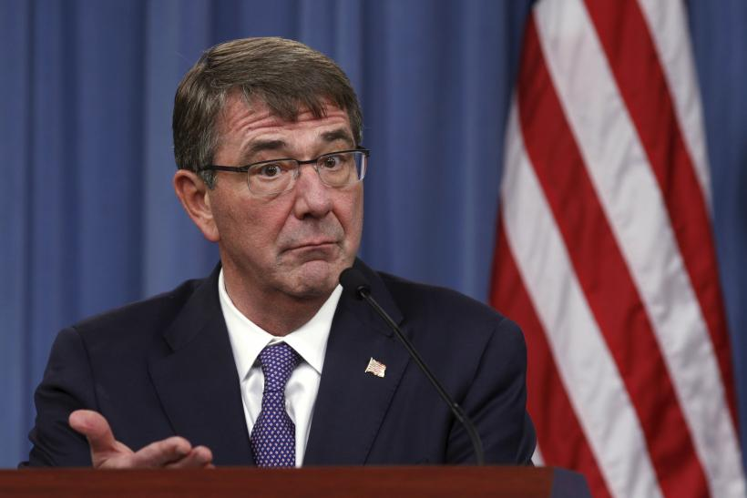 U.S. Secretary of Defense Ash Carter gestures during a press conference.