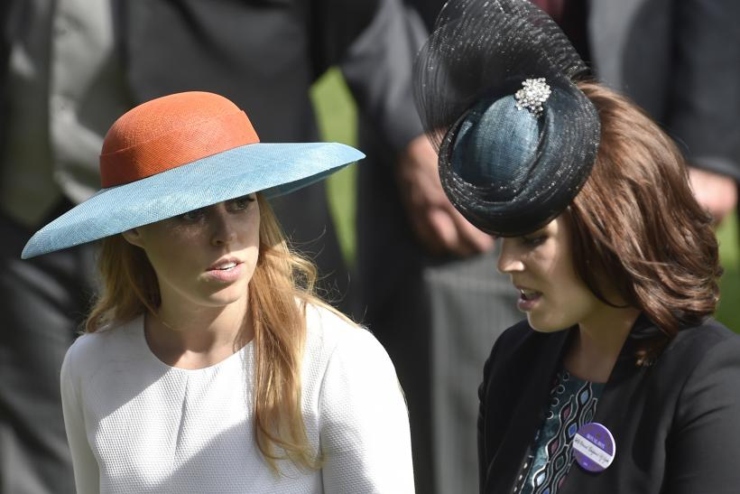 Britain's Princess Beatrice (L) and her sister Princess Eugenie
