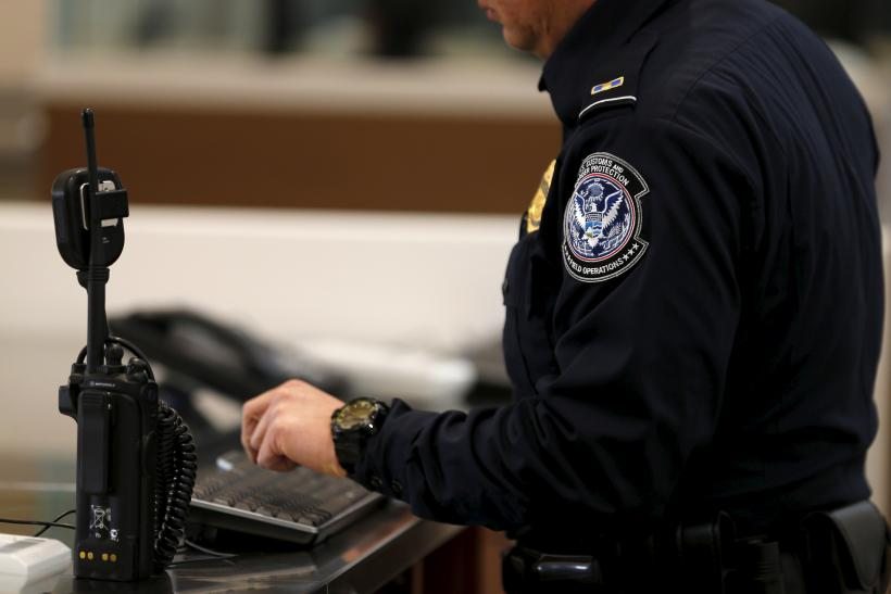 An immigration official at work