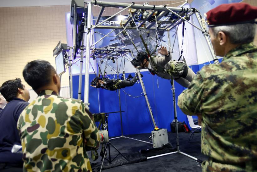 Soldiers use a parachute simulator