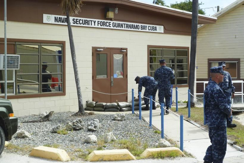 U.S. Navy personnel complete tasks at the Guantanamo Bay prison in Cuba.