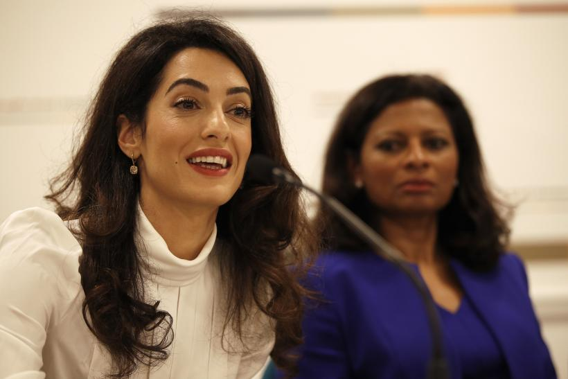 Lawyer Amal Clooney (L) and Laila Ali, wife of former president of Maldives