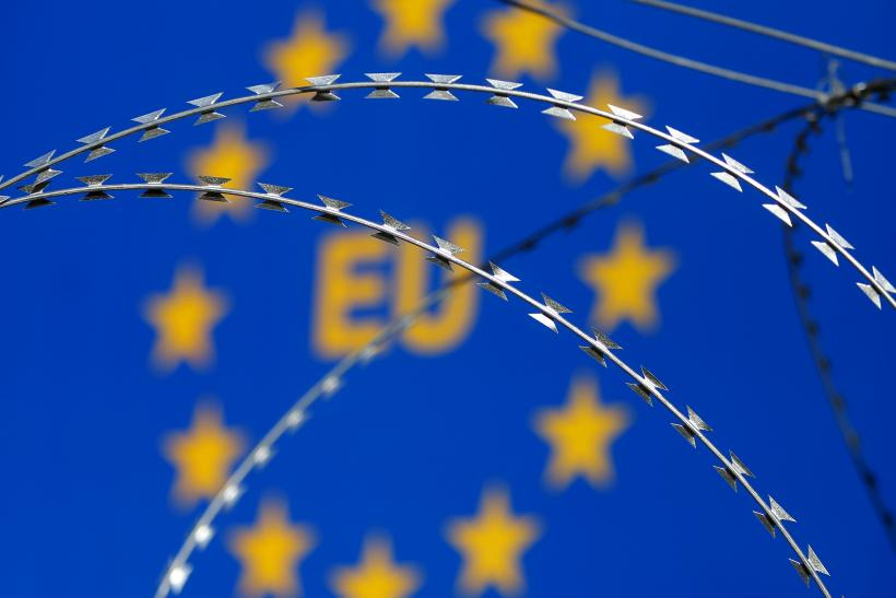 An E.U. sign behind razor wire at a protest in Slovenia.