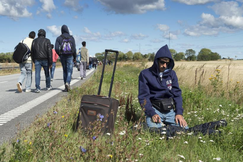A refugee takes time to prays while journeying through Denmark.