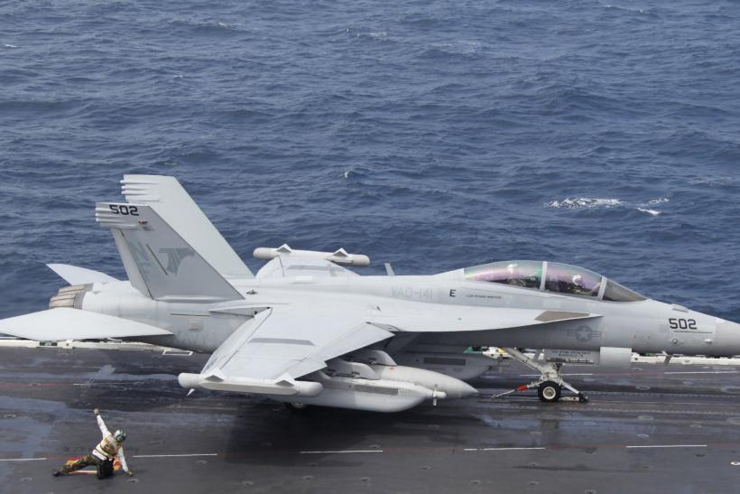 A Super Hornet takes off on the deck of the USS George Washington
