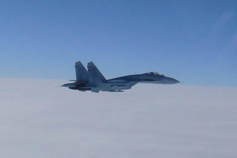 An Su-27 flying near to the sea of Japan.