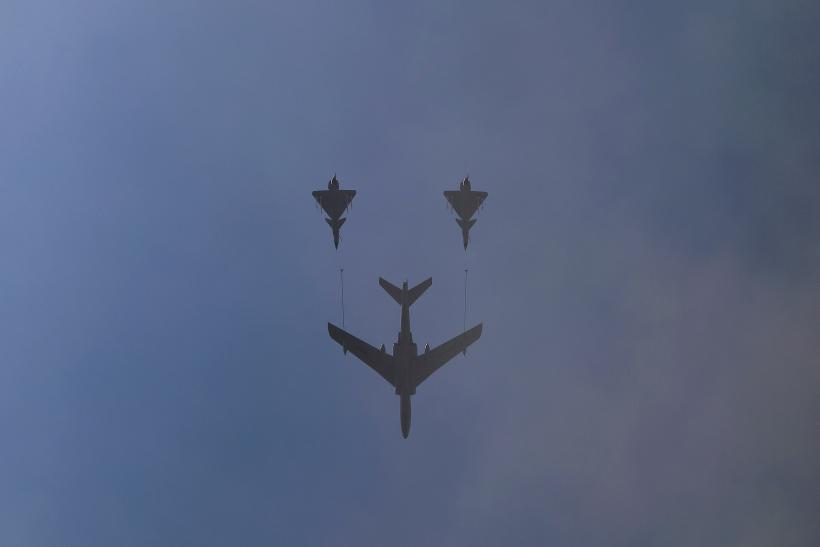 Three military aircraft fly above Beijing during celebrations.