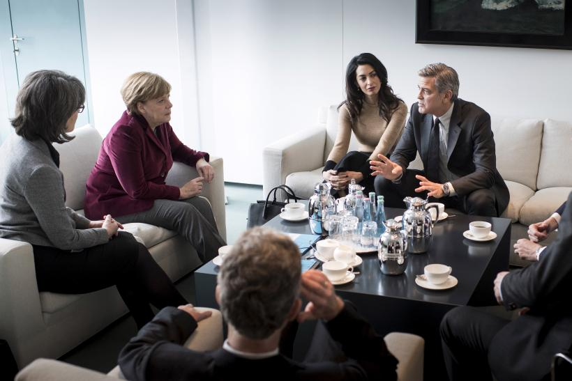 German Chancellor Angela Merkel along with actor George Clooney and his wife Amal