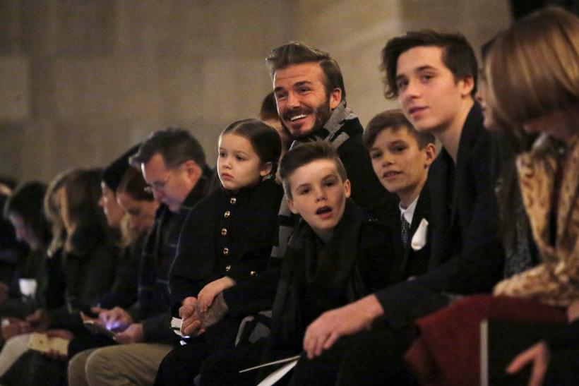 David Beckham sits in the front row at the Victoria Beckham Fall/Winter 2016 collection presentation with his children