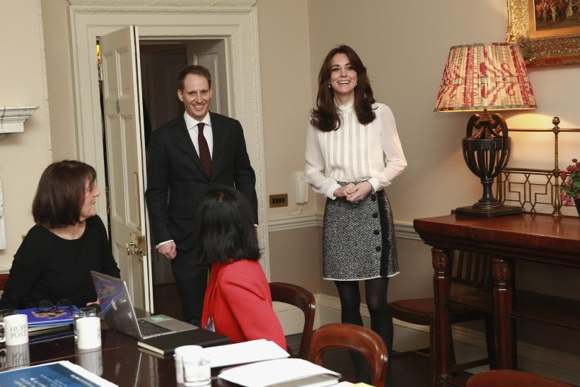 Britain's Catherine, Duchess of Cambridge wears Reiss top and D&G skirt