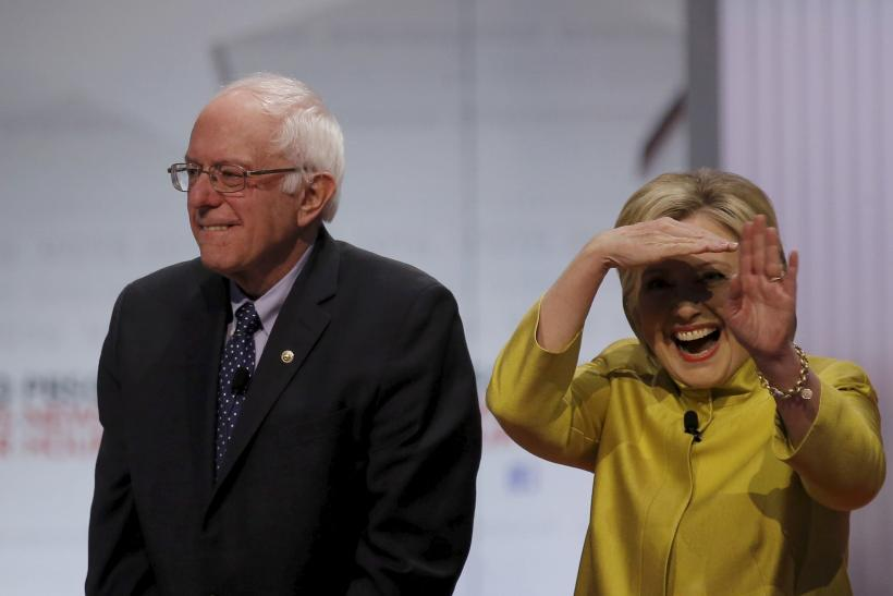 Bernie Sanders and Hillary Clinton on stage at the start of a debate.