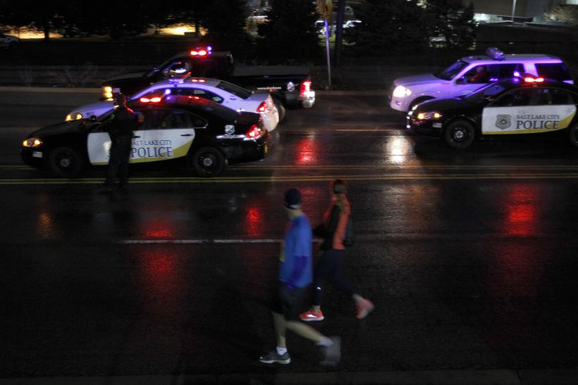 Salt Lake City police battle rock-throwers after shooting