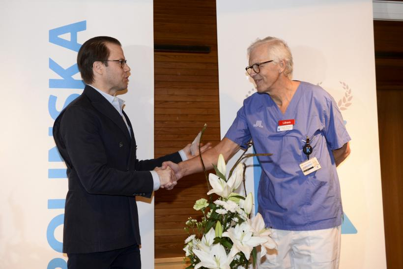 Sweden's Prince Daniel shakes hands with doctor Lennart Nordstrom