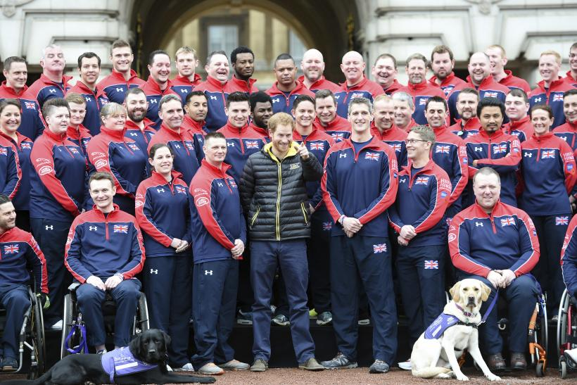 Prince Harry poses for a photo with members of Great Britain's Invictus Games team