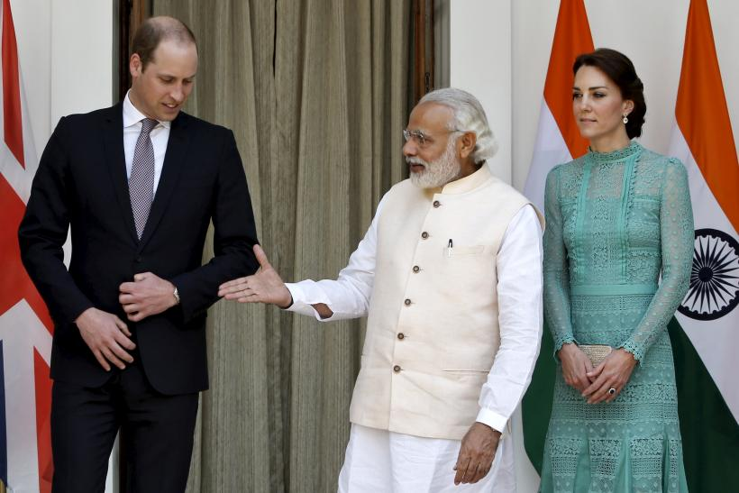 Britain's Prince William shakes hands with India's Prime Minister Narendra Modi (C) as Catherine, Duchess of Cambridge looks on
