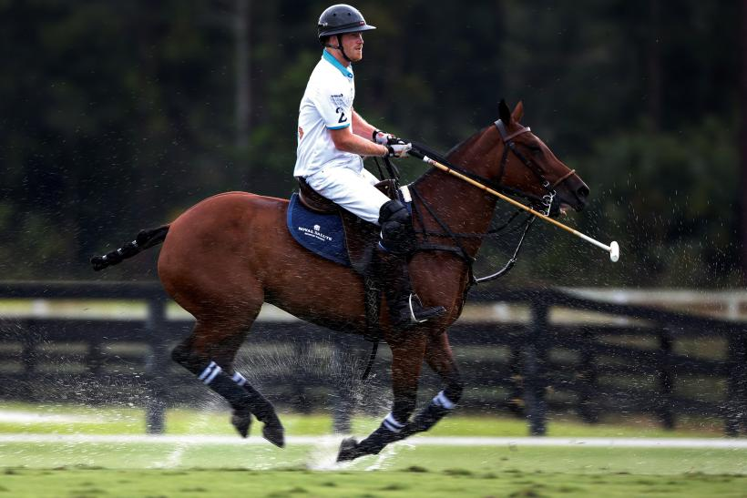 Prince Harry plays polo in the rain