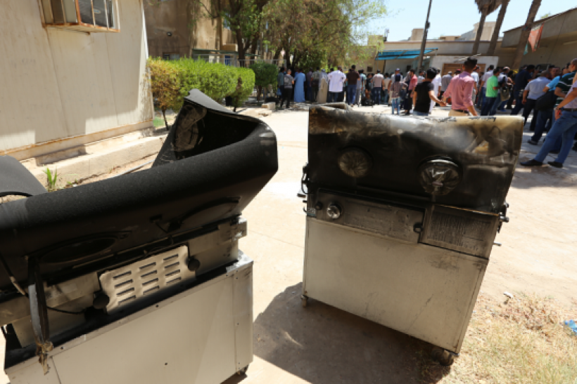 Burnt incubators stand outside Yarmuk hospital in west Baghdad on August 10, 2016 after an overnight fire tore through the maternity ward, killing at least 11 premature babies, medical and security sources said.