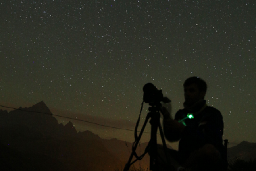 A photographer prepares to take pictures of the annual Perseid meteor shower in the village of Crissolo, near Cuneo, in the Monviso Alps region of northern Italy, on August 13, 2015.