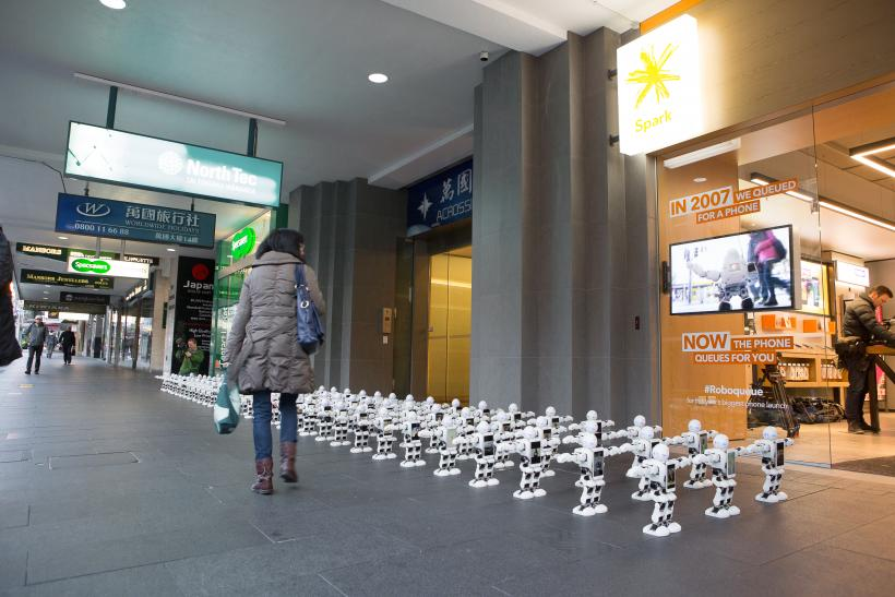 100 Robots queuing for Spark customers to get phone 02