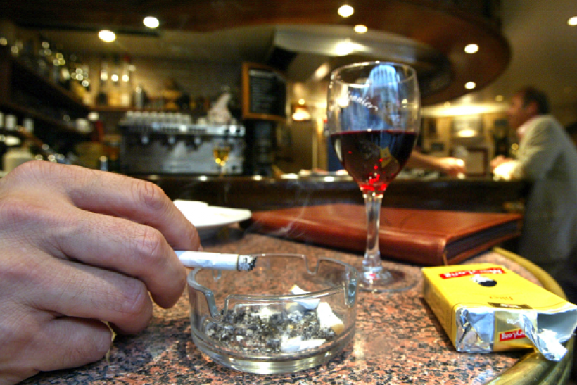 A new study shows having a glass of red wine before a cigarette can reduce chances of damage.