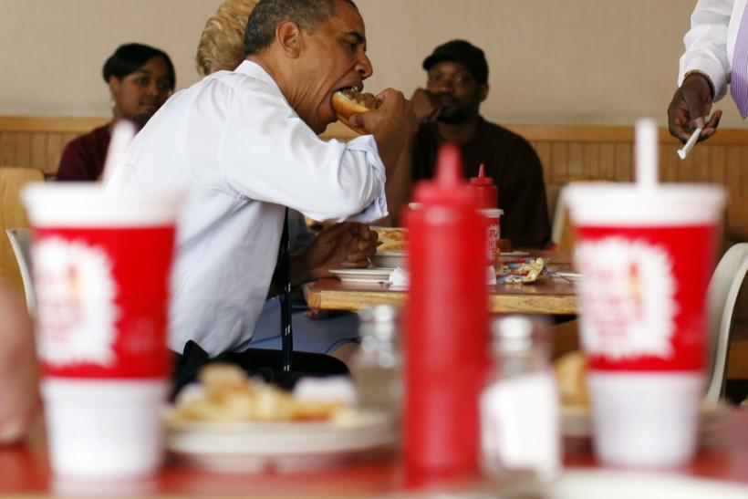 U.S. President Barack Obama eats his lunch at Rudy's Hot Dog in Toledo, Ohio