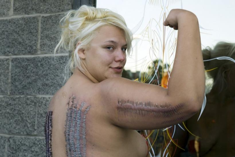 Sideshow performer Staysha Randall poses outside Inktoxicated Tattoos after breaking the Guinness Book record in Las Vegas