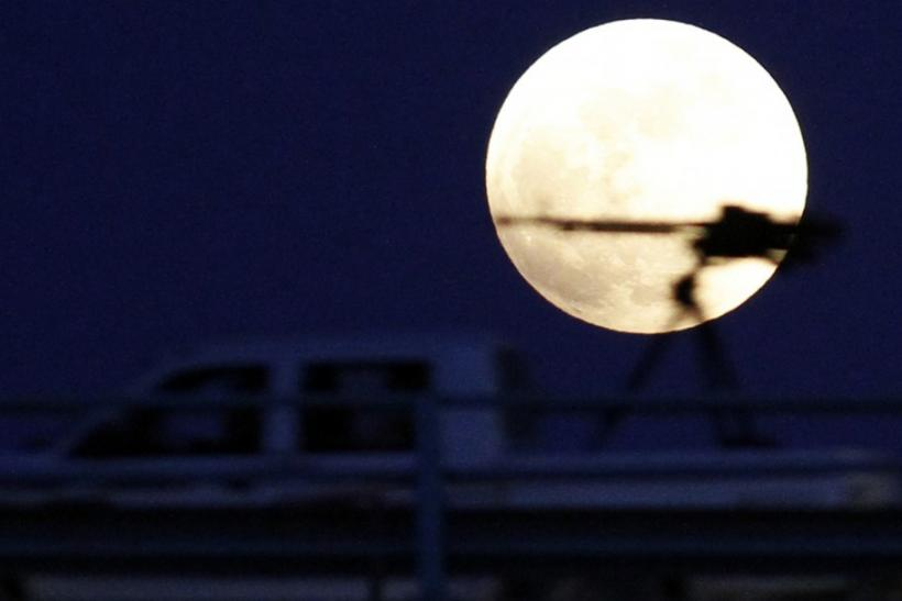 A heavy machine gun on a rebel fighter's vehicle is pictured against the moon during a total lunar eclipse in Benghazi