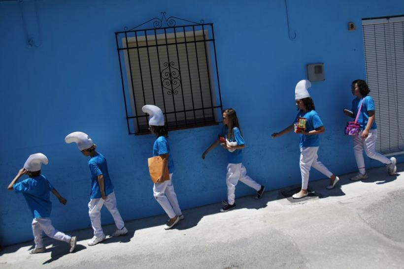 Children dressed up as smurfs take part in a promotional event in the Andalusian village of Juzcar
