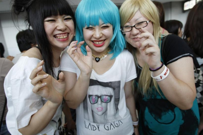 Lady Gaga fans pose for a photo as they wait for her arrival at Narita International Airport.