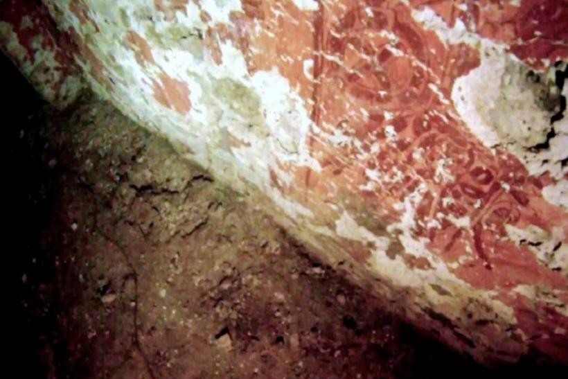 Undated handout photo by the INAH shows red frescoes inside the tomb of a Mayan ruler at the ruins of the Mayan city of Palenque in the Mexican state of Chiapas