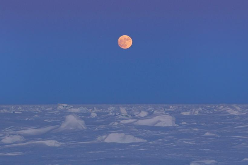 The moon rises over Arctic ice