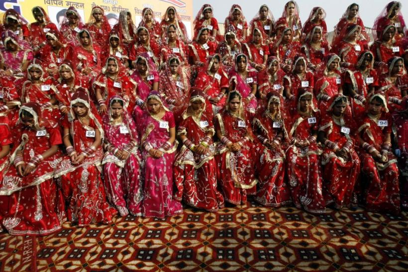 Hindu brides sit during a mass wedding ceremony in Noida December 26, 2009. A total of 101 couples from the city took wedding vows on Saturday during the mass wedding ceremony organised by a Hindu voluntary organisation, organisers said