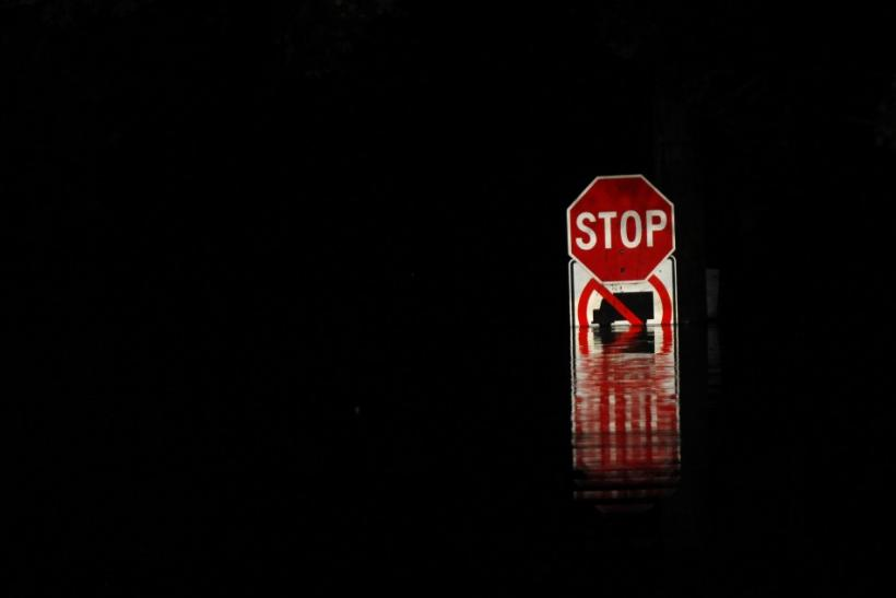 A street sign is submerged in floodwaters from the Susquehanna River in West Pittston