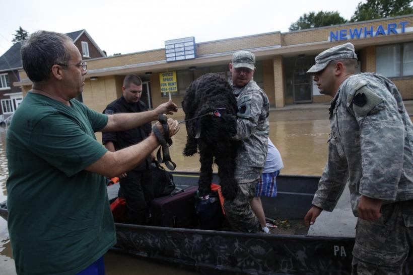 U.S. National Guard troops rescue David Rowlands and his dog Cupcake from floodwaters from the Susquehanna River in West Pittston