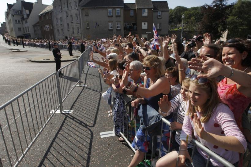 Spectators wave after the marriage between Zara Phillips and Mike Tindall at Canongate Kirk in Edinburgh