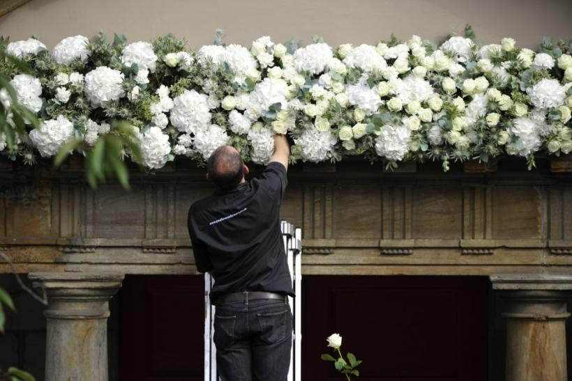 Workers put the finishing touches to Canongate Kirk before the marriage of Britain's Zara Phillips and Mike Tindall in Edinburgh