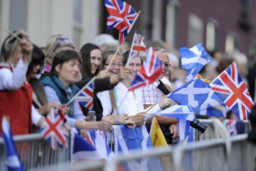 Spectators wave flags before the marriage between Britain's Zara Phillips and Mike Tindall in Edinburgh