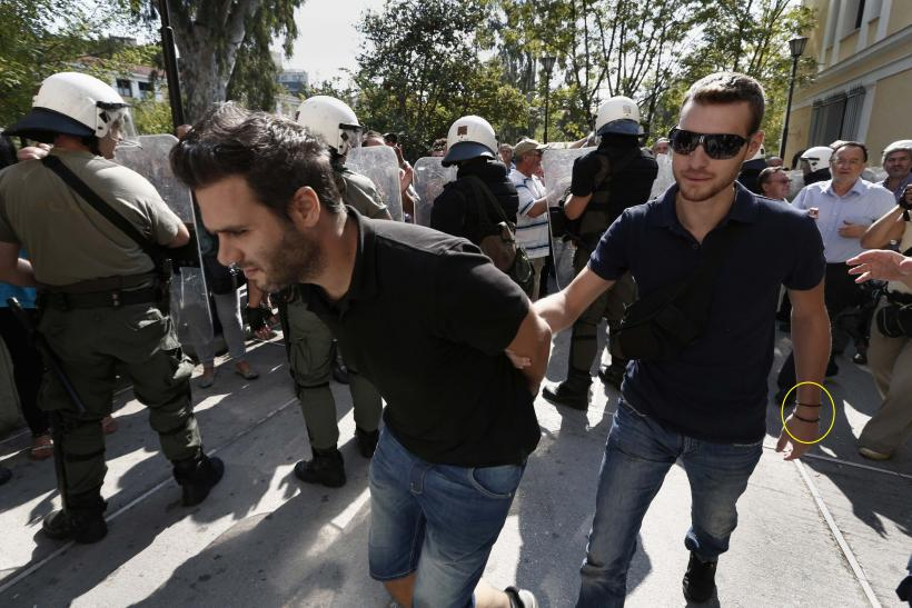 A striking shipyard worker is arrested by a plainclothes policeman during demonstrations on October 5.