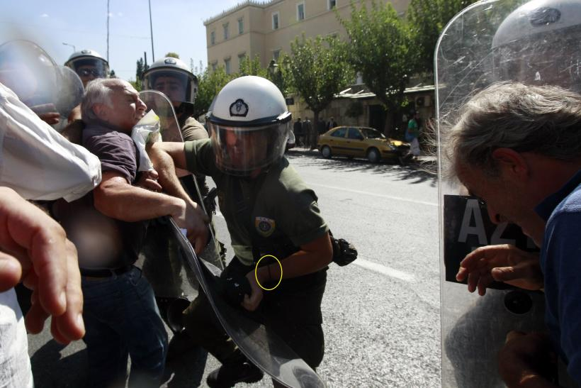 Protesters are pushed back by police during a rally against cuts to services for people with disabilities on September 27.