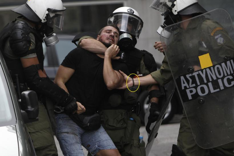 A protester is arrested during demonstrations in Athens in October 9.