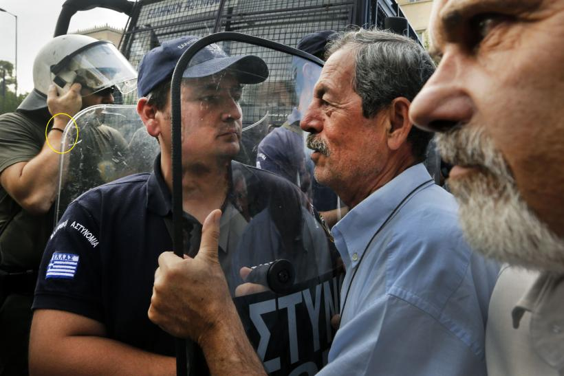 Retirees clash with police during demonstrations against austerity measures in Athens October 8.