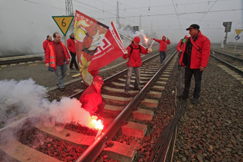 In Brussels, railroad workers also joined in, using flares to prevent trains from running smoothly during a solidarity protest.