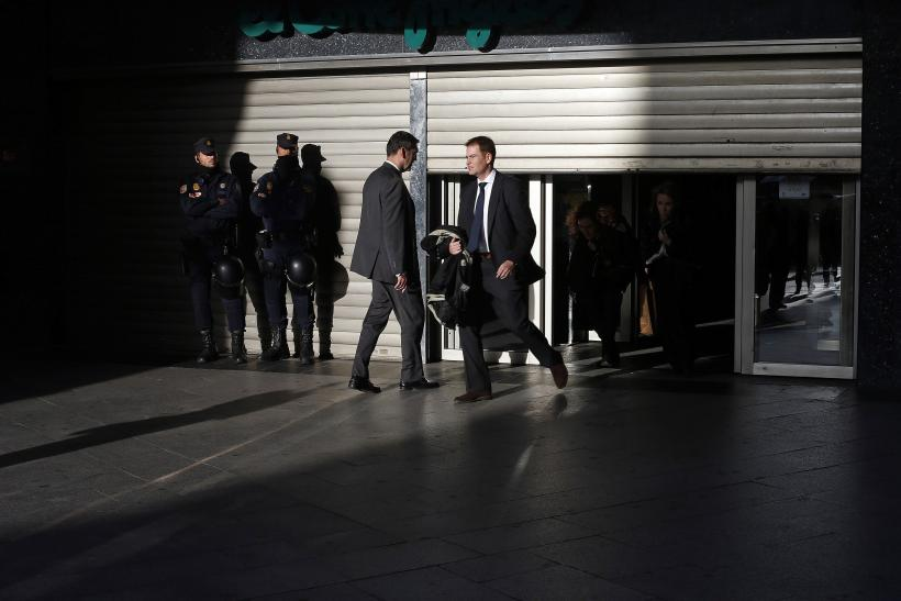 Police also offered protection to customers and employees of a department store, which operated with the shutters half-drawn throughout the day.