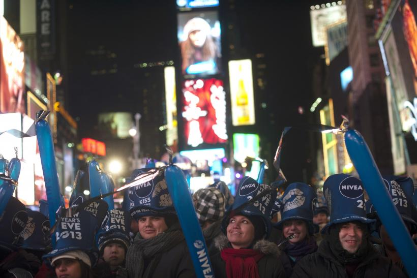 Revelers stand in Times Square
