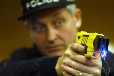 Police demonstrating a Taser gun