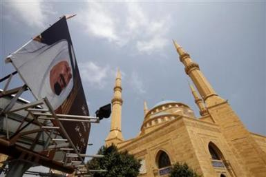 Billboard depicting Saudi Arabia's King Abdullah is erected near al-Amin mosque in Beirut