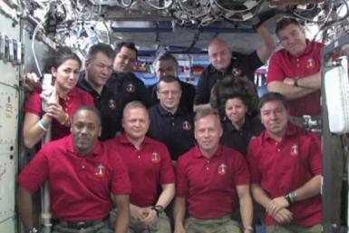 Space shuttle Discovery crew members and other astronauts working at the ISS talk to President Barack Obama.